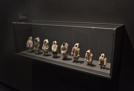Akitiq Sanguya. (Dolls), 1975. fur (caribou/sealskin), leather, stone. (Left to right) Man in Sealskin Outfit, Woman in Sealskin Outfit, Woman in Traditional Dress, Man in Traditional Dress, Woman in Traditional Dress, Man in Traditional Dress, Child's Traditional Dress, Child in Traditional Dress. Government of Nunavut Fine Art Collection, On long-term loan to the Winnipeg Art Gallery, 2.75.14 to 2.75.21.