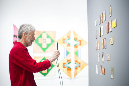 MIKAELA MACKENZIE / WINNIPEG FREE PRESS Artist Cliff Eyland takes pictures of his work at the new fall exhibit, The 80s Image, at the Winnipeg Art Gallery in Winnipeg on Thursday, Sept. 27, 2018.  Winnipeg Free Press 2018.