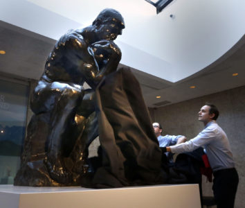 WAYNE GLOWACKI / WINNIPEG FREE PRESSGallery staff Luke Palka,right, and Andrew Kear have the honour unveiling the sculpture THE THINKER by Auguste Rodin in the Skylight Lounge at the Winnipeg Art Gallery Friday. The 408kg. bronze sculpture was lent to the gallery by a private collector and will be on exhibit until spring. Dec.16 2016