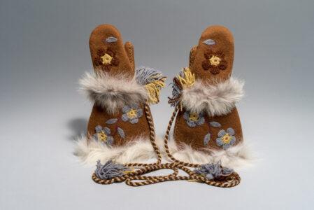 Mona Rebecca Ittiraqtaataq. Canadian (Taloyoak), b. 1941. Mittens, 1976.wool, wool duffle, wool yarn, embroidery thread, fur;(a) : 40 x 26.5 x 6 cm; (b) : 40 x 26.5 x 6 cm.Government of Nunavut Fine Art Collection. On long-term loan to the Winnipeg Art Gallery, 2.76.22 ab.Photo: Lianed Marcoleta