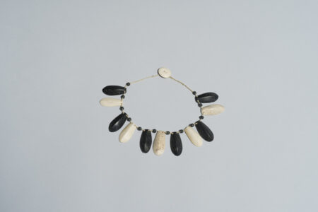 Sakkiassee Anaija. Necklace, 1978. bone (whale), stone, sinew. 17 x 215 x 235 x 23 cm. Government of Nunavut Fine Art Collection; On long-term loan to the Winnipeg Art Gallery, 2.79.8.