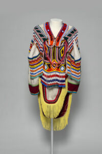 Unidentified artist. Amautik, c. 1995. wool duffle, glass beads, nylon fringe, cotton ribbon, cotton thread, and felt, 150 x 90 cm. Collection of the Winnipeg Art Gallery; Gift of Helen Webster in honour of Thomas Webster and his contribution to representing Inuit artists and the promotion of Inuit Art and Culture, 2018-160.