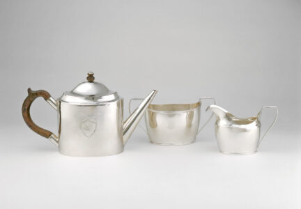 Pierre Huguet dit Latour, Sr. (workshop of) (Canadian, 18th century). Tea service, c. 1790–1800. silver, wood. (a) teapot: 17.8 x 11.1 x 30 cm; (b) sugar bowl: 10.5 x 20.1 x 9.4 cm; (c) cream jug: 10.3 x 7.8 x 15.7 cm. Collection of the Winnipeg Art Gallery; Acquired with a repatriation grant from the Government of Canada through the Cultural Property Export and Import Act and donations from friends in memory of Mrs. Bernard Naylor, G-83-241 abc. Photo: Ernest Mayer