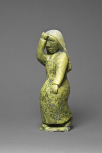 Oviloo Tunnillie (Canadian (Cape Dorset), 1949–2014). Grieving Woman, 1997, stone (green serpentinite) 35 x 12.5 x 11.3 cm. Collection of the Winnipeg Art Gallery. Gift of the Volunteer Committee to the Winnipeg Art Gallery in commemoration of the Volunteer Committee's 50th Anniversary, 1948-1998, 1999-499. Photograph: Ernest Mayer, courtesy of the Winnipeg Art Gallery.