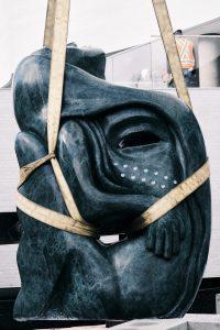 Goota Ashoona (b. 1967, Kinngait). Tuniigusiia/The Gift, 2020. Verde Guatemala marble. Collection of the Winnipeg Art Gallery. Commissioned by The Manitoba Teachers' Society on behalf of Manitoba's public school teachers. Installation photo: Calvin Lee Joseph.