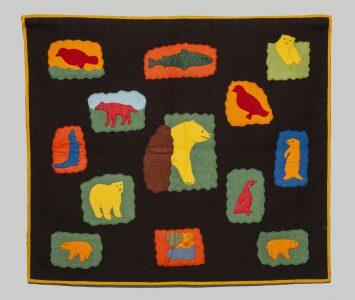 Agnes Nanook Sewoee (Canadian (Arviat), b. 1957).Life Scenes, 1984.wool duffle, felt, embroidery floss,74.5 x 84 cm.Collection of the Winnipeg Art Gallery. Gift of Leah Erickson (aka Maureen Bereskin), 2018-206.Photo: Ernest Mayer.